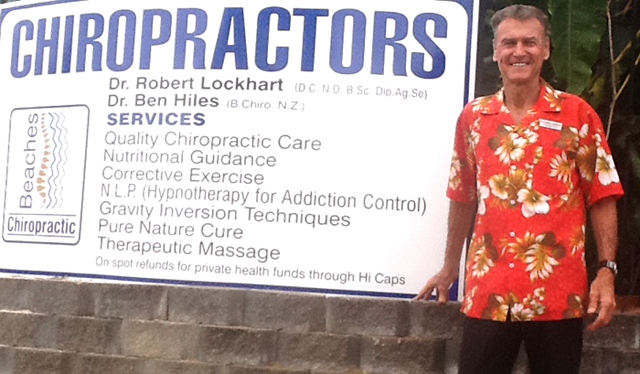 Robert-Lockhart-beside-chiropractors-sign